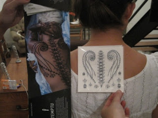 House of Dereon Spine Tattoo is Lilliputian